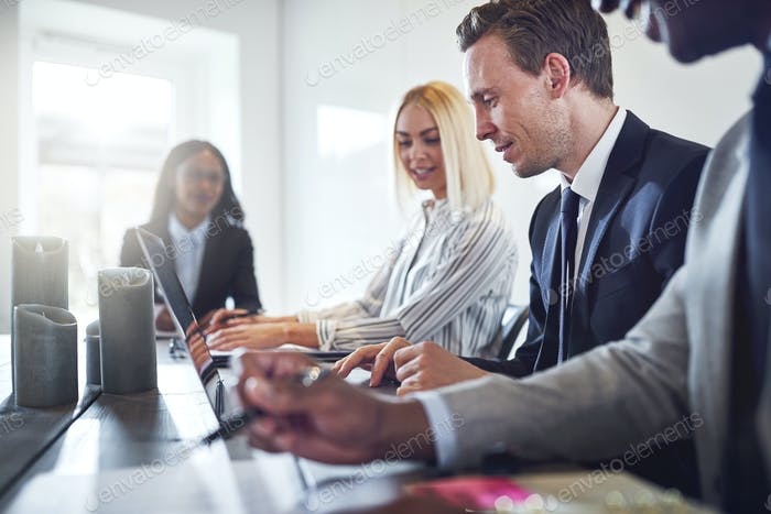 Diverse businesspeople having a meeting together in an office