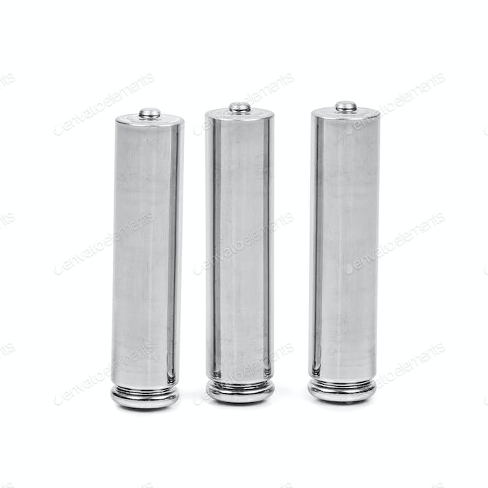 Three AAA batteries on white background