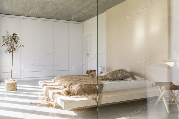Light bedroom with bed