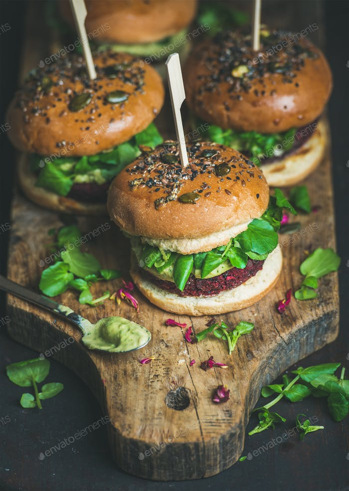 Healthy homemade vegan burger with beetroot-quinoa patty and avocado sauce