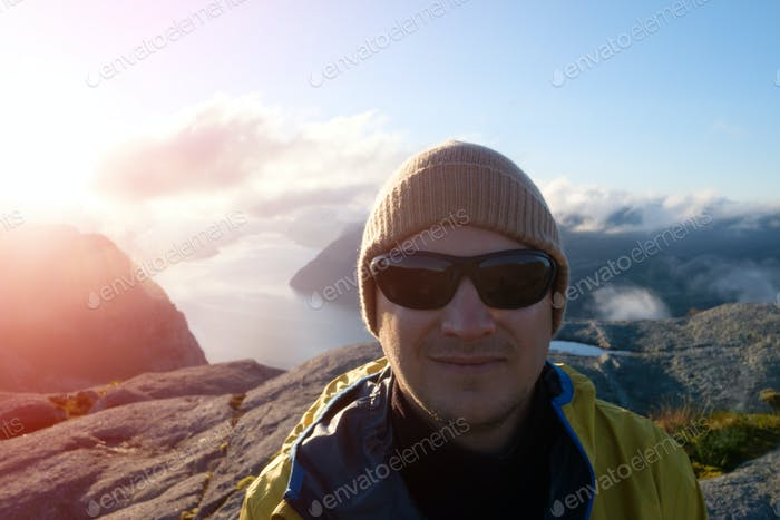 Traveler portrait on Lysefjorden fjord