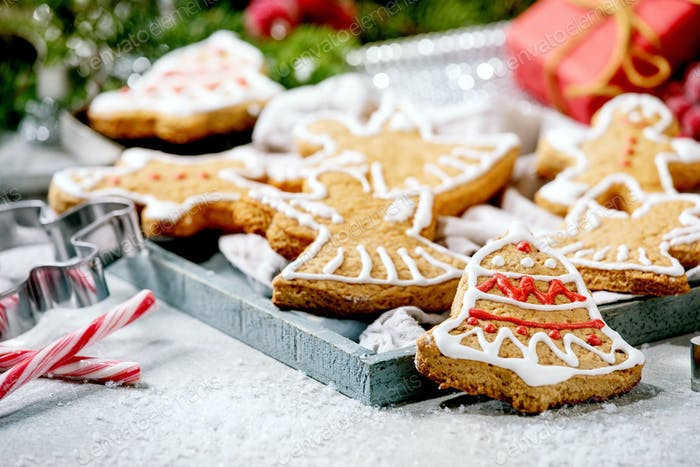 Christmas gingerbread cookies with icing ornate. Xmas decorations, white background.