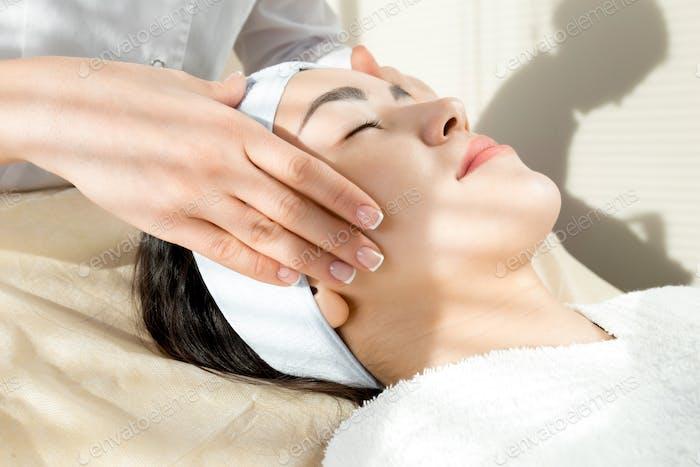 Woman Enjoying Face Massage