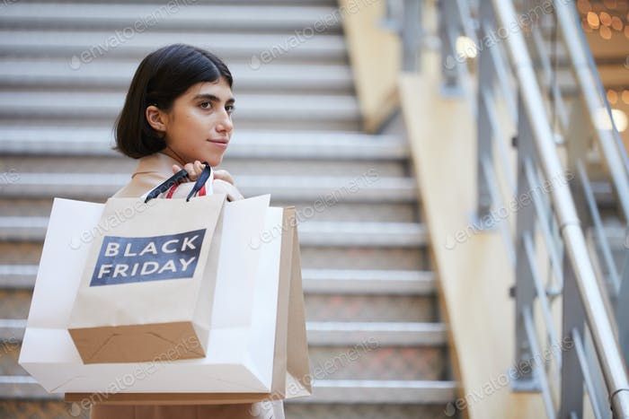 Young Woman Holding Shopping Bags on Black Friday
