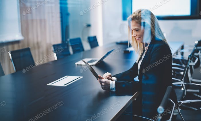 Businesswoman using tablet in conference room