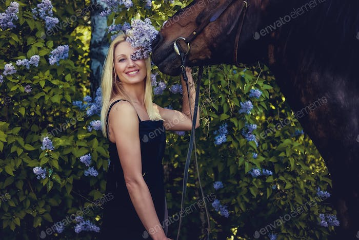 Blond female posing with horse.