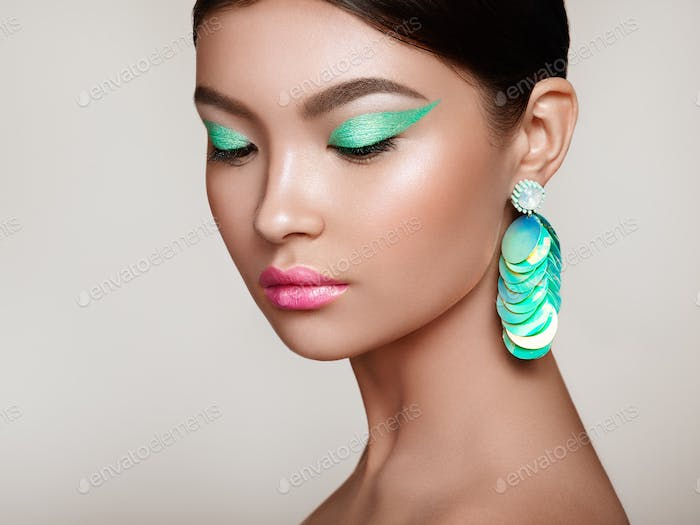 Beautiful Korean Woman with large turquoise earrings