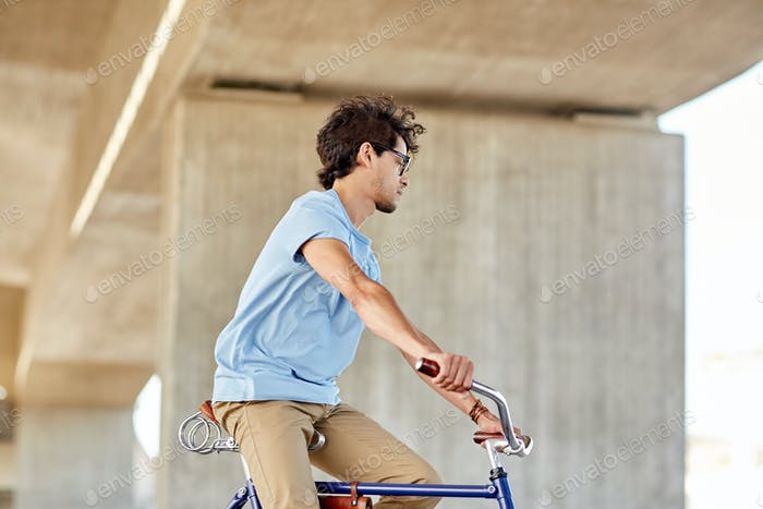 hipster man riding fixed gear bike