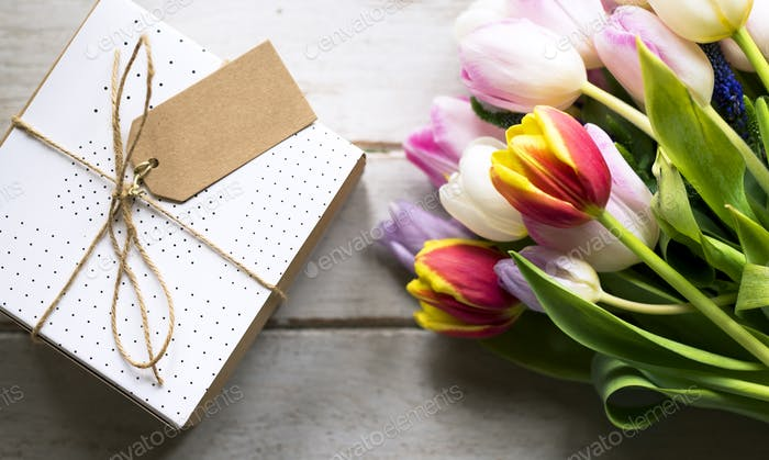 Tulip Flowers and Present with Design Space Empty Tag on Wooden