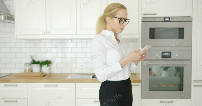 Beautiful businesswoman using phone