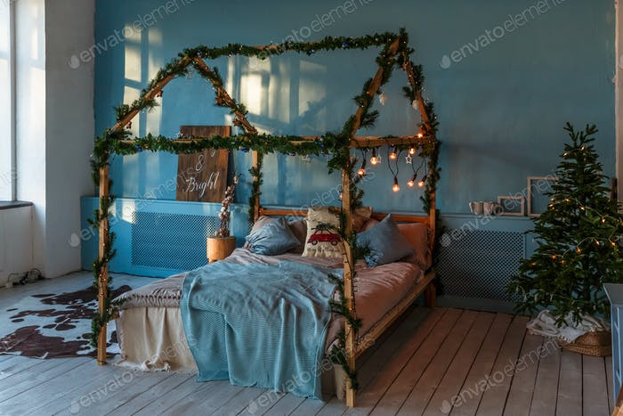 Christmas and New Year decorated bedroom. Loft style