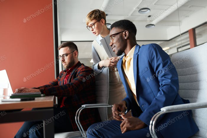 Side View at Business Team Working in Office