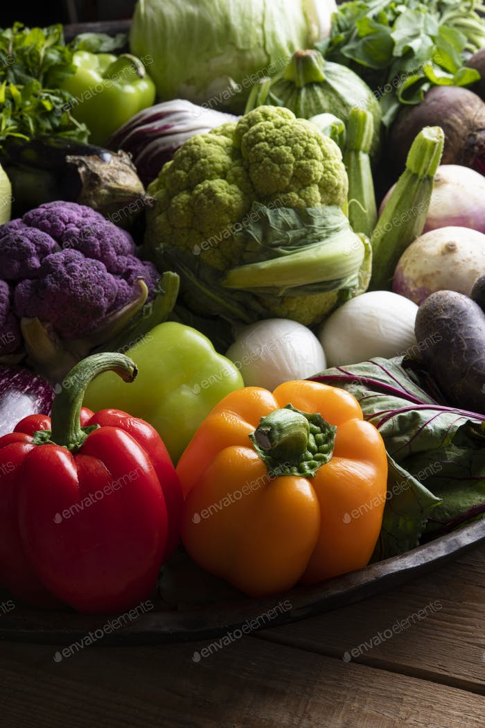 Large baking pan with fresh mixed colourful vegetables