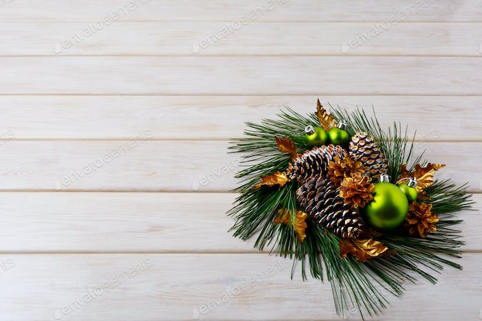 Christmas greeting with pine branches and golden cones