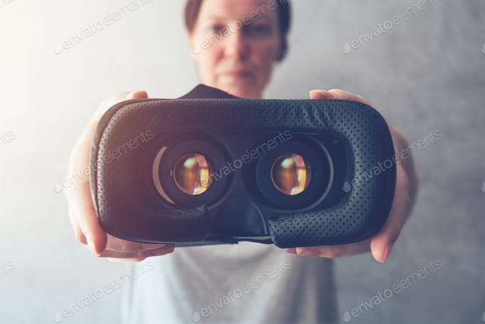 Woman offering VR headset