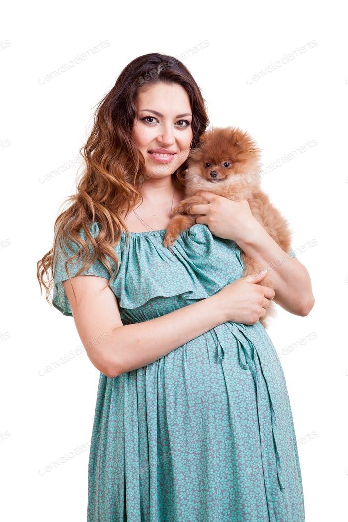 Pregnant woman and her dog over white background