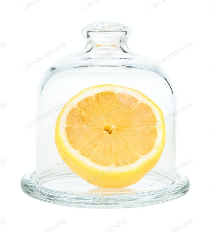 halved fresh lemon in Glass Lemon Keeper isolated