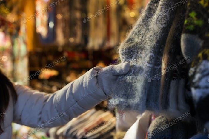 woman buying woolen socks at christmas market