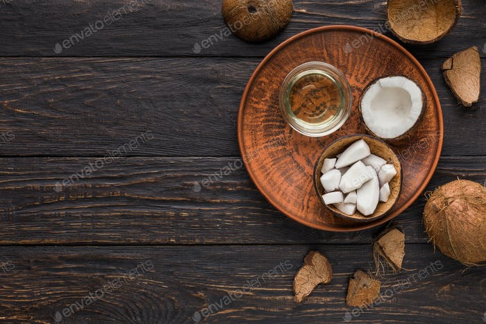 Coconut products over wooden background