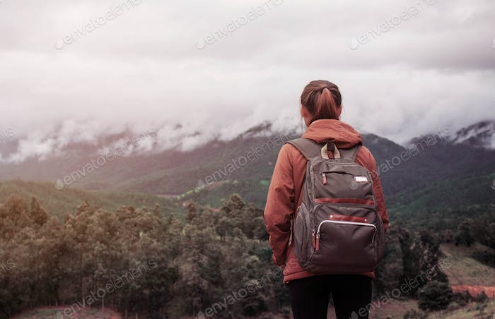 Girl with traveling on mountain