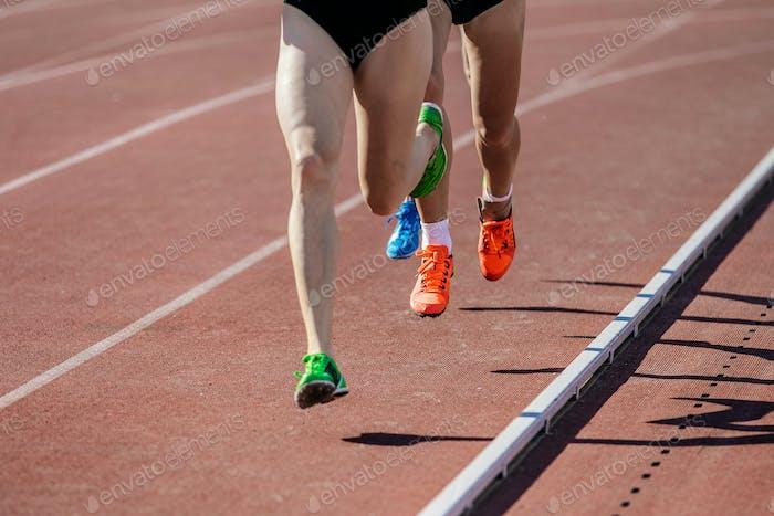 Girls Runners Run on Track Stadium