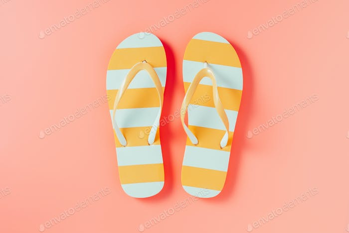 Flip flops on pink background
