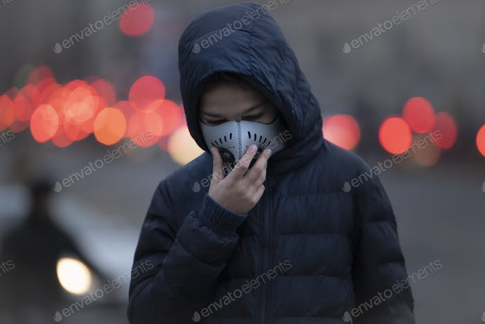 Young Person wearing Anti-Pollution Mask, Polluted Air, City Street