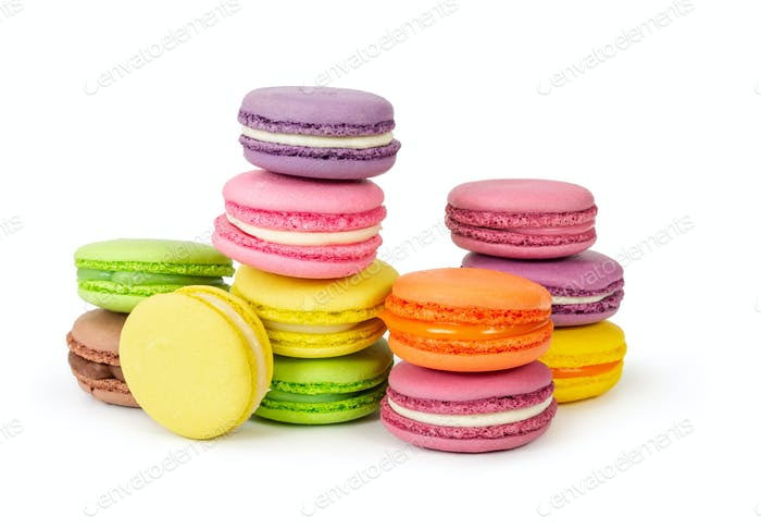 Different colorful french macaroons isolated on white