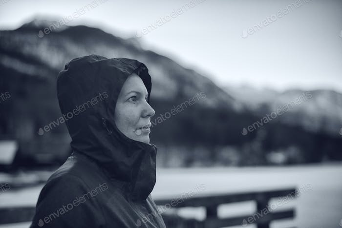 Beautiful female with hooded jacket outdoors
