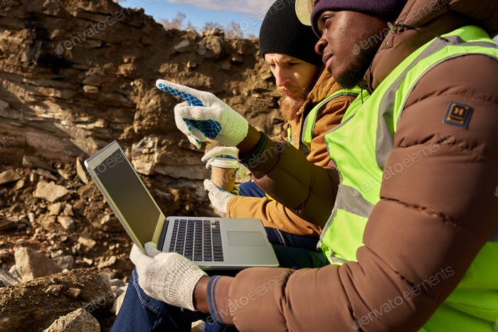 Mining  Workers Using Laptop on Excavation Site