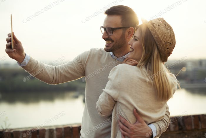 Couple in love taking selfies while traveling