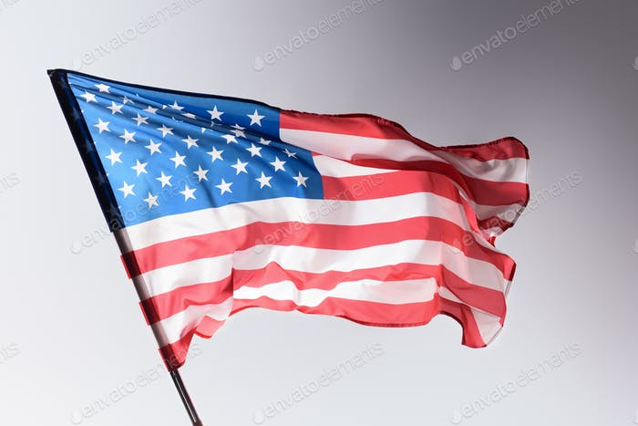 waving united states flag on grey, Independence Day concept
