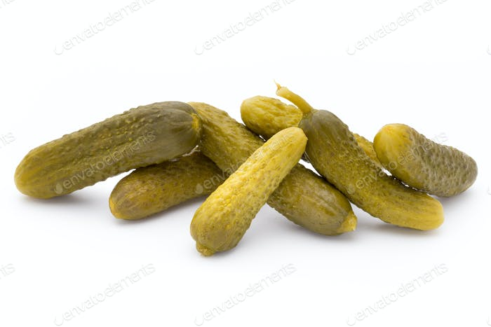Marinated pickled cucumbers isolated on the white.