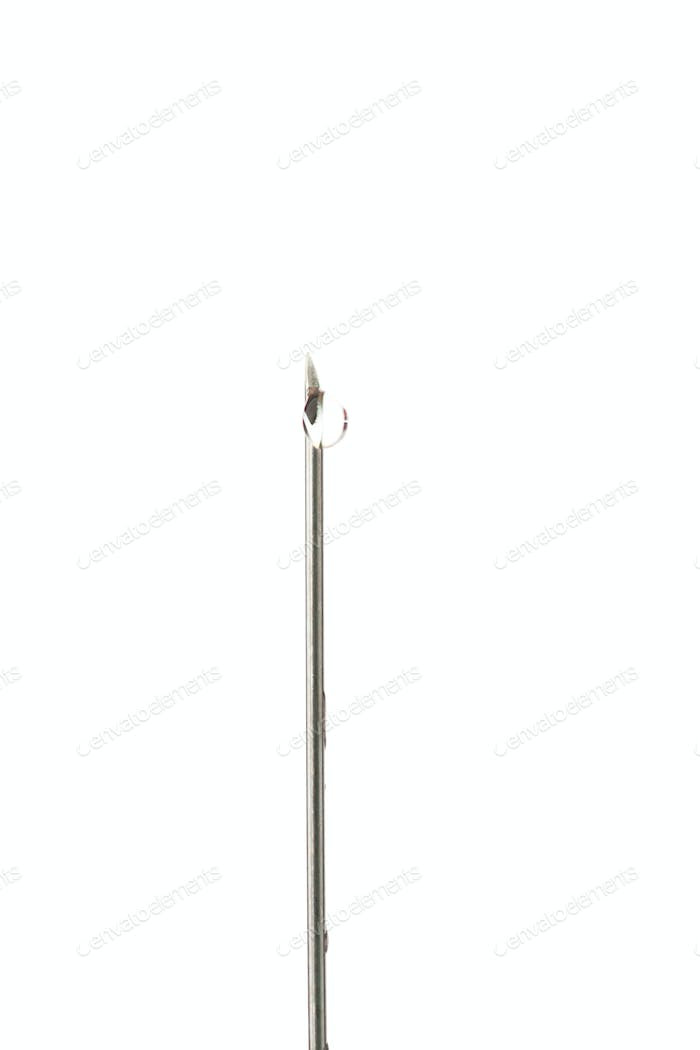 Drop outgoing of a needle against white background