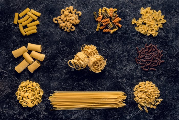 flat lay composition of raw pasta variation