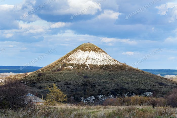 Distant view of chalk butte hill in autumn