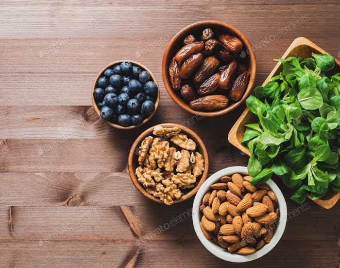 Healthy vegan food - dry fruits, greens