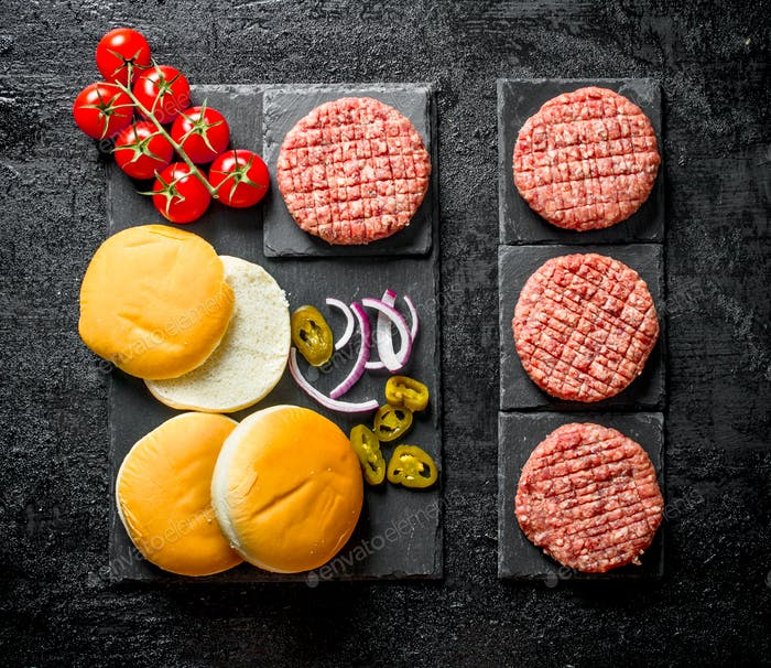 Raw burgers. Cooking of beef Burger patties.