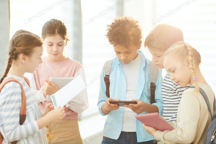 Busy Middle Schoolers In School Corridor