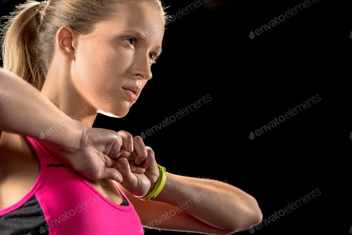 Athletic woman exercising and warming up hands