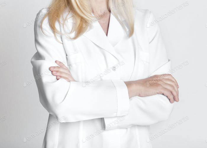 Female doctor in white uniform with crossed arms