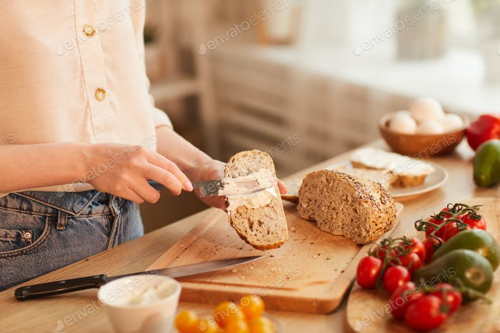 Young Woman Making Sandwiches for Breakfast
