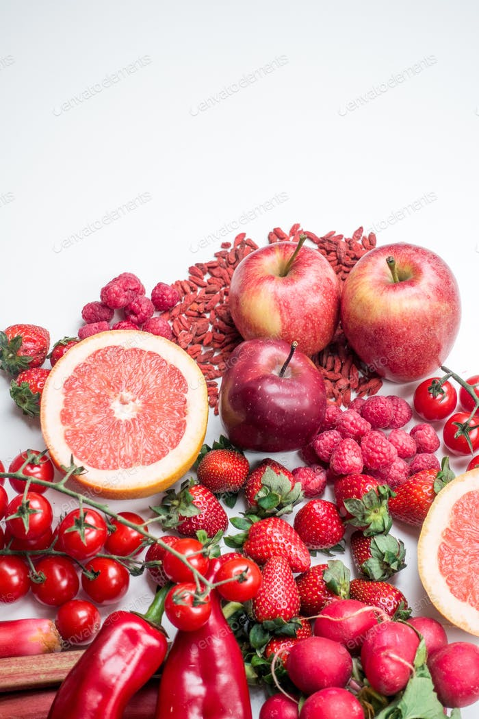 Vibrant shot of red fruit and vegetables on a white background