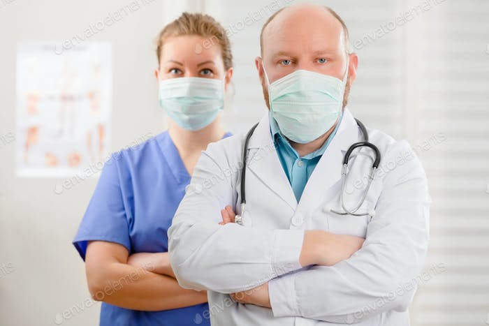 Confident and Exhausted Doctor And Nurse With Arms Crossed In Hostpital