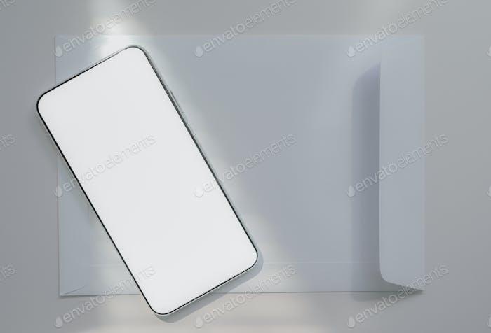 Nahaufnahme eines Smartphones auf einem weißen Umschlag platziert, Kommunikationskonzept.