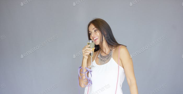 Happy young woman partying at New Year