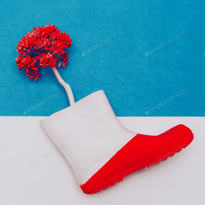 Rubber boot and flower. Minimal art