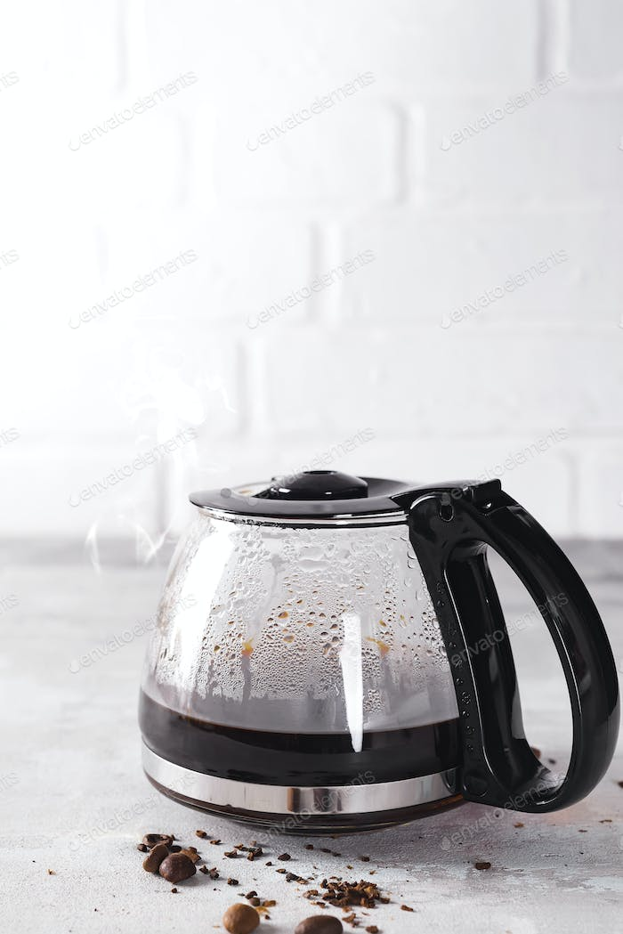 Coffee maker pot filling with coffee beans