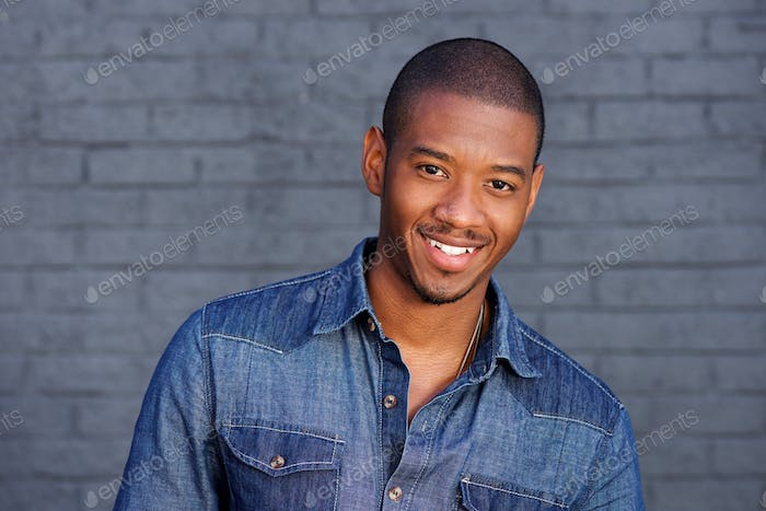 cool black guy smiling with blue shirt