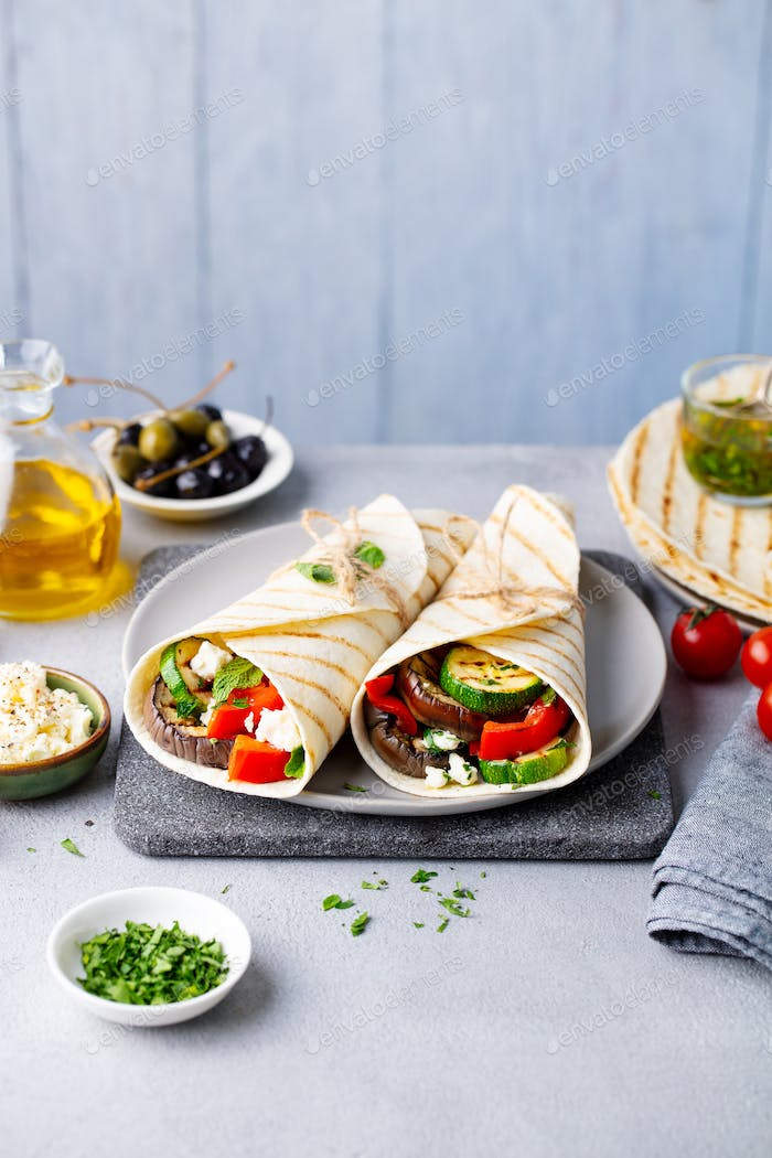 Wrap Sandwich With Grilled Vegetables and Feta Cheese on a Plate. Grey Background. Copy Space.